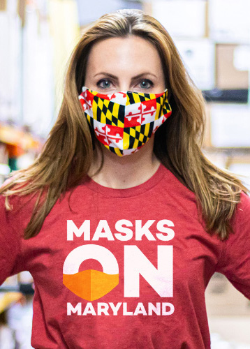 Woman with mask wearing a 'Masks On Maryland' shirt